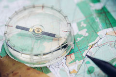 Compass is on the map. Next to the pencil royalty free stock photography