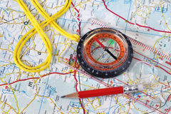 Compass on the map. Сompass and pencil on a background map Royalty Free Stock Photography