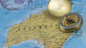 Compass on a close up map pointing at Australia and planning a travel destination. Stock Photography