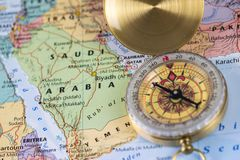 Compass on a close up map pointing at Saudi Arabia and planning a travel destination. Stock Photography