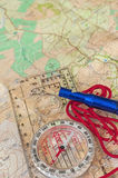 Compass on Map and Rescue Whistle Royalty Free Stock Photos