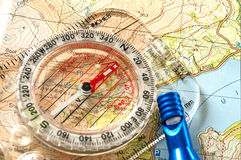 Compass on Map and Rescue Whistle Royalty Free Stock Photo
