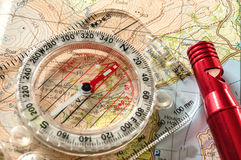 Compass on Map and Rescue Whistle Royalty Free Stock Image