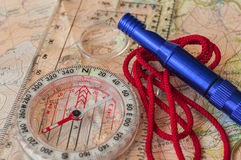 Compass on Map and Rescue Whistle Stock Image