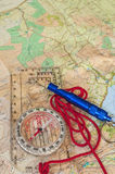 Compass on Map and Rescue Whistle Royalty Free Stock Photography