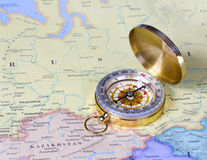 Compass on map of Russia royalty free stock photo