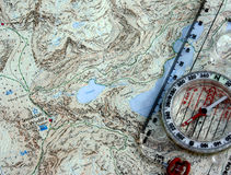 Compass and map. A compass and map showing the mountain of Snowdon in Wales Stock Images