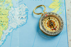 Compass, map. On a table Royalty Free Stock Photography