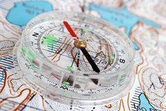 Compass and map. Compass and topographic map closeup Stock Image