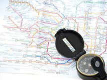 Compass on a map Traveling in Japan royalty free stock photos