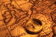 Compass and Map of UK and Europe. Ancient compass and old map of the UK and Europe, showing London and Paris royalty free stock image