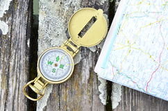 Compass and map. On the wooden background stock photo