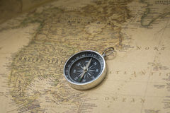 Compass and map. Compass on the world map. Assistant to travel the world Stock Images