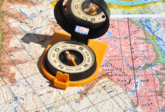 Compass and  maps. Stock Images