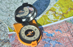 Compass on the maps. Royalty Free Stock Photo