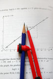 Compass on maths book. Compass and pencil on maths text book Stock Photo