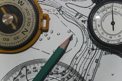 Compass a metre of curves and pencil on topographic map 1 Royalty Free Stock Photo