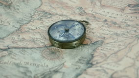 A compass in the middle of the map stock video