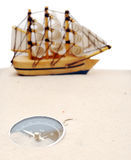 Compass  and model classic boat Royalty Free Stock Image