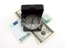 Compass on money. Compass on different types of banknotes Royalty Free Stock Images
