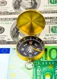 Compass and money Stock Photos