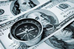 Compass and money Royalty Free Stock Images