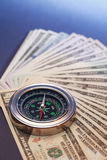 Compass On Money. Business concept. Closeup of compass on USA dollar bank notes Stock Image