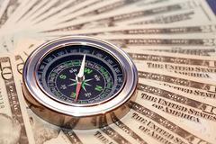 Compass On Money. Business concept. Closeup of compass on USA dollar bank notes Stock Photography