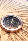 Compass On Money. Business concept. Closeup of compass on USA dollar bank notes Stock Photo