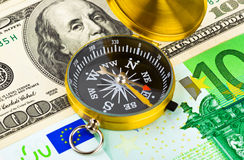 Compass and money Stock Image