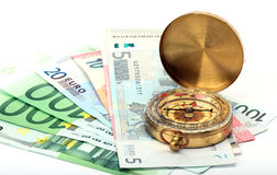 Compass and money Royalty Free Stock Image