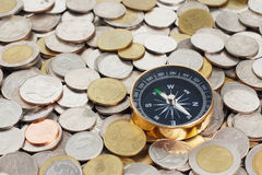 Compass and money. Gold compass on money background Royalty Free Stock Photos
