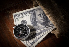 Compass with money in gunny sack. Stock Photo