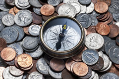 Compass Money Finance Management Services. A compass with a dollar sign where N should be, on an American coins background Stock Images