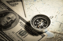 Compass with money on map. Stock Photography