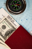 Compass, money and passport Stock Photos