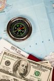 Compass, money and passport Stock Photography