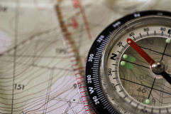 Compass Mono. A compass sitting on a map stock images