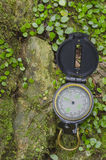 Compass on Mossy Rock Royalty Free Stock Photos