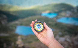 Compass in mountains Stock Image