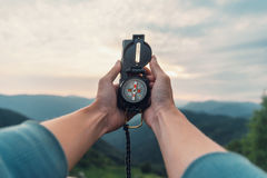 With compass in mountains Stock Photography