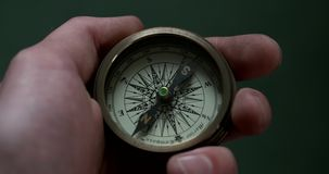 Compass movement at hand. Video recorded with 4k quality that shows someone is holding the compass stock video