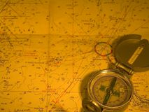 Compass and nautical map royalty free stock image