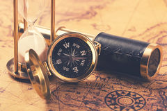 Compass and nautical vintage equipment on old world map Stock Image