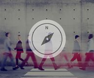 Business people walking with compass navigation graphic overlay royalty free stock photography