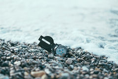 Compass near the sea waves Royalty Free Stock Photos