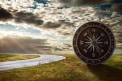 Compass next to road stock photos