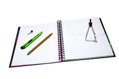 Compass with notebook, pen and cutter Stock Photography