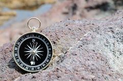 Compass and Ocean - Orientation Concept Royalty Free Stock Photos