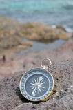 Compass and Ocean - Orientation Stock Photography